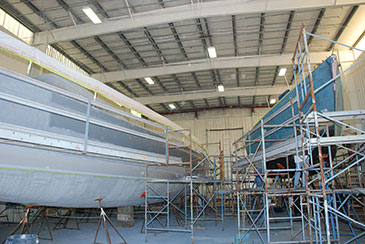 NEB's reputation for quality paintwork is centered in Building 4. Power and sailing yachts are moved in and out of this building weekly throughout  the winter months for hull, deck and interior paint and varnish projects.