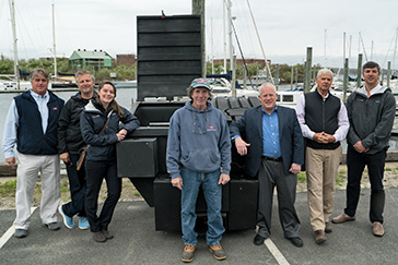 Photo Courtesy of 11th Hour Racing - NEB owners, Clean Ocean Access Executive Director Dave McLaughlin, and Representatives from 11th Hour Racing with the new Trash Skimmer